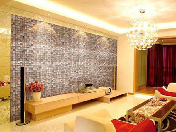 将晶体马赛克作为电视背景墙的装饰,时尚感十足。复杂的马赛克搭配一个简约的电视柜,效果好极了。 客厅马赛克电视背景墙装修案例