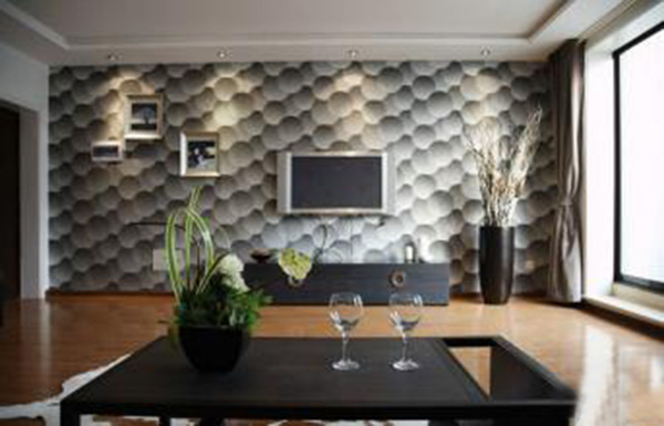 整个电视背景墙马赛克采用类似鹅软石图案,现代感十足。搭配黑色简单古朴的茶几,非常独。 客厅马赛克电视背景墙装修案例