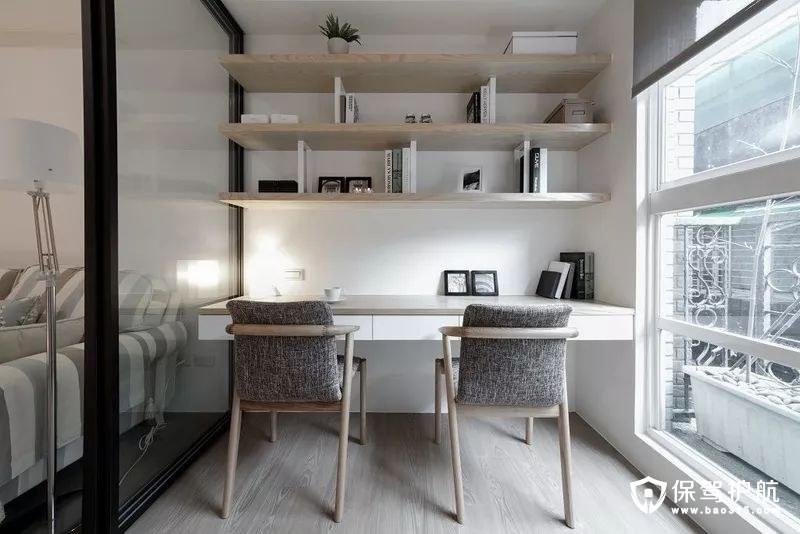 简约书房书桌以及靠墙悬挂的设计