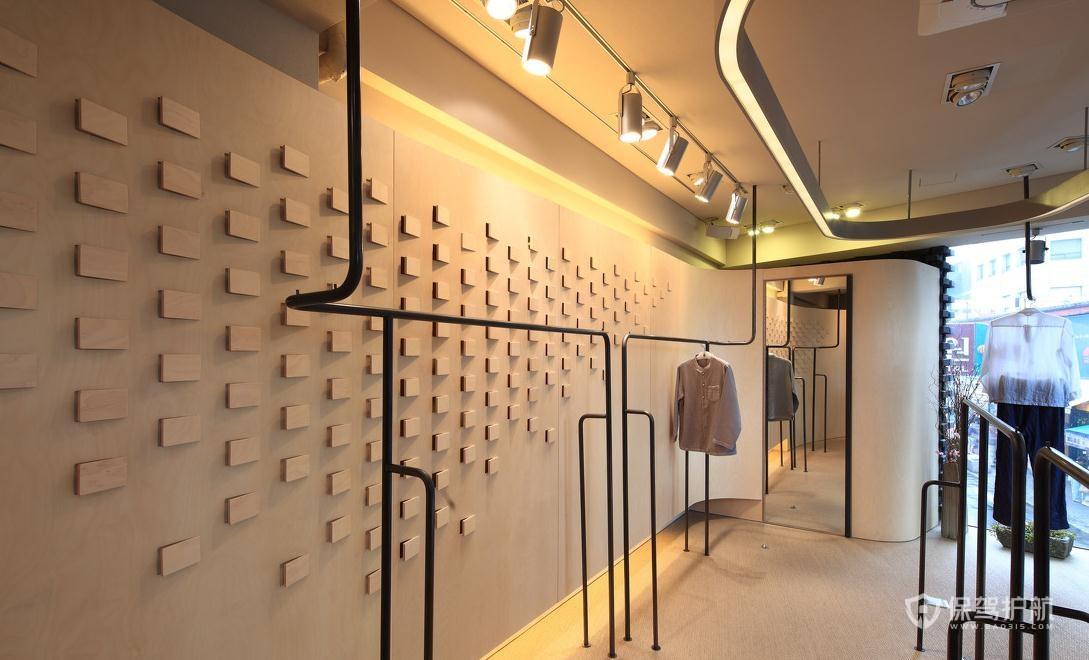 创意背景墙服装店装修实景图